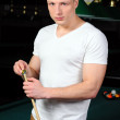 Portrait of a young man playing snooker — Stock Photo #22488591