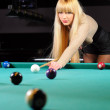 Stock Photo: Young girl playing snooker