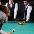Group of young professionals playing snooker — Stock Photo