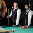 Group of young professionals playing snooker — 图库照片