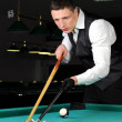 Young person playing snooker in a club — Stock Photo