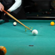 Young person playing snooker in a club — Foto de Stock
