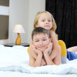 Stock Photo: Brother and sister on bed
