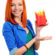 Stock Photo: Pretty young woman eating french-fries