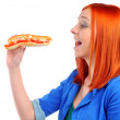 Stock Photo: Young woman eating fast food
