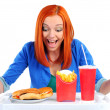 Woman eating fast food. Isolated — Stock Photo #22795698