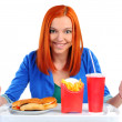 Woman eating fast food. Isolated — Stock Photo