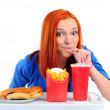 Stock Photo: Woman eating fast food. Isolated