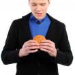Man eating a hamburger — Stock Photo