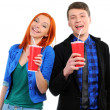 Stock Photo: Young couple drinking cola isolated on white