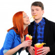 Young eating french-fries — Stock Photo