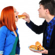 Royalty-Free Stock Photo: Young people eating hamburger