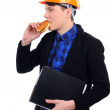 Young man in a helmet eating burger — Stock Photo