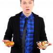 Isolated young man with burgers and salad — Stock Photo