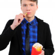 Isolated man eats French fries — Stock Photo