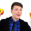 Young man holding apple and hamburger, isolated on white — Stock Photo