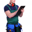Handsome industrial contractor using wireless tablet device — Stock Photo