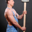 Handsome builder with a sledgehammer and sexy body — Stock Photo