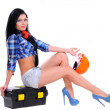 Girl in a helmet with a box for tools — Stock Photo