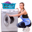 young house wife near washing machine with loundry — Stock Photo
