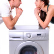 Beautiful young couple with a washing machine — Stock Photo