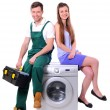 Repairman and young girl sitting on the washing machine — Stock Photo