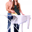 Young couple irons clothes isolated on white - Stock Photo