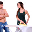 Young couple irons clothes isolated on white — Stock Photo