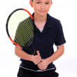 Child with a tennis racket isolated on a white — Stock Photo