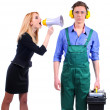 Woman yells in megaphone on the plumber — Stock Photo #24611195