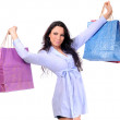 图库照片: Womholding shopping bags against white background