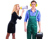 Woman yells in megaphone on the plumber — Stock Photo