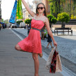 Stock Photo: Photo of young joyful womwith shopping bags