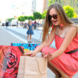 Photo of young joyful woman with shopping bags — Stock Photo