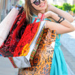 Fashion lady of holding shopping bags in modern city. — Stock Photo
