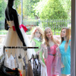 Stock Photo: Three elegant women look in clothes store showcase