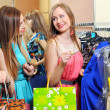 Two smiling woman shopping in retail store — Stock Photo #25404301