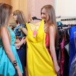 Two smiling woman shopping in retail store — Stock Photo #25404321