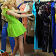 Young girl in a shop buying clothes - Stockfoto