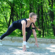 FItness woman preparing to run from a starting low position — ストック写真
