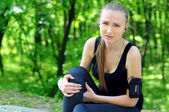 Sport woman holding her injured leg — Stock Photo