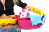 Sexy cleaning lady posing with cleaning equipment — Stock Photo