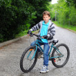 Portrait of a cute boy on bicycle — Stock Photo