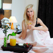 Young beautiful woman having breakfast in bed — Stock Photo