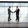 Two young businessman handshake on business meeting at modern office and representing success — Stock Photo