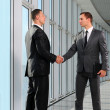 Cheerful businesspeople, or businessman and client, handshaking — Stock Photo