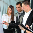 Group of business looking at the graph on flipchart — Stock Photo
