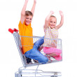 Two children - girl and baby - with shopping cart in supermarket — Stock Photo