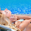 Woman in poolside — Stock Photo
