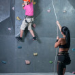 Foto Stock: Climbing the wall